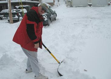 MISC-061201-Tim_Shovels_Snow-Small